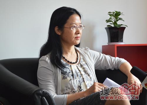 昆明理工大学建筑工程学院副教授、房地产经营管理教研室主任邓晓盈